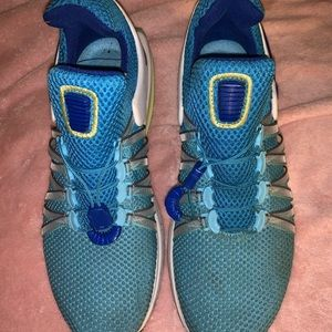 Blue yellow Nike running shoes Size: 7